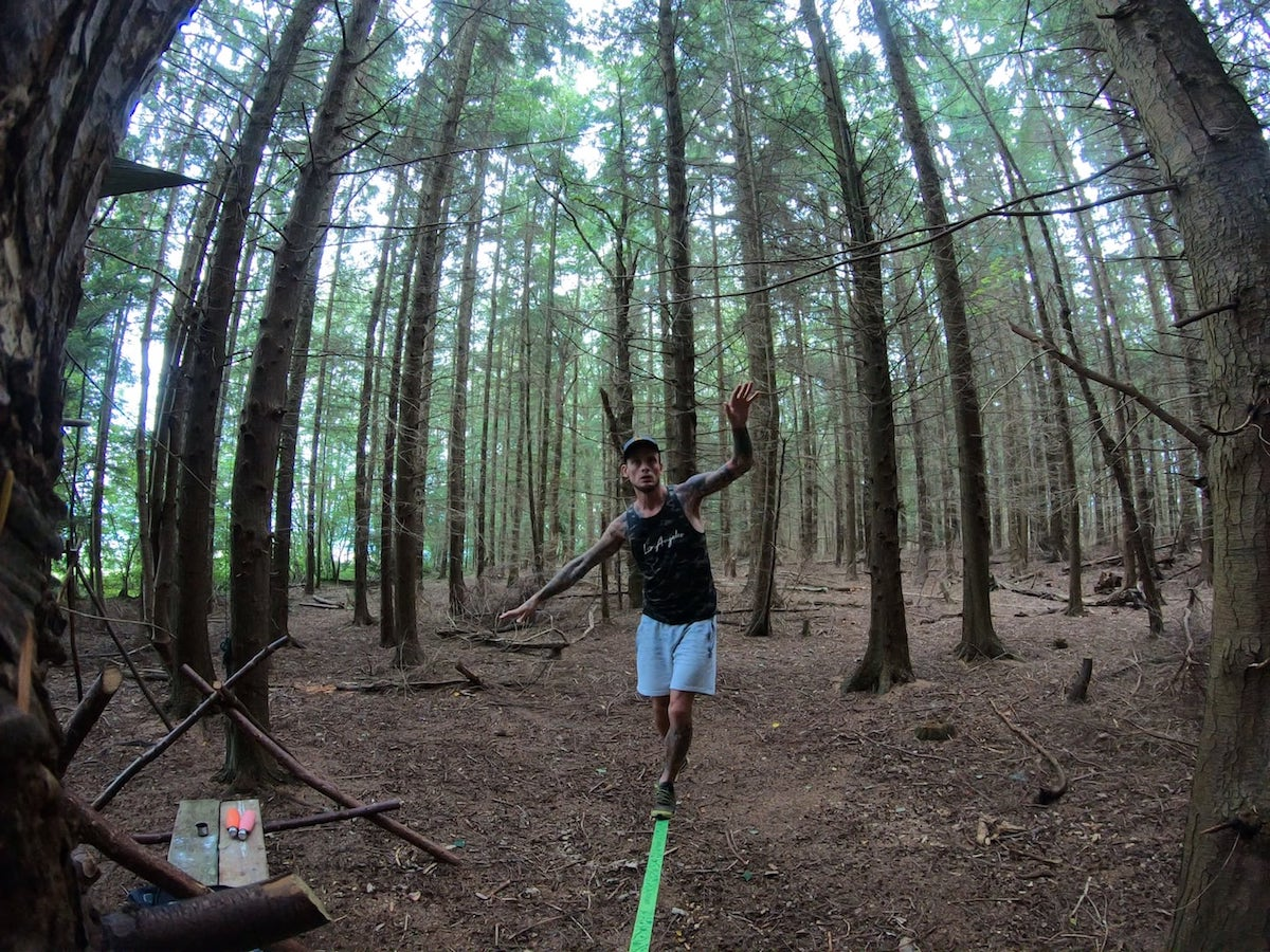 Macaco Slackline in a forest | The Frozen Divide