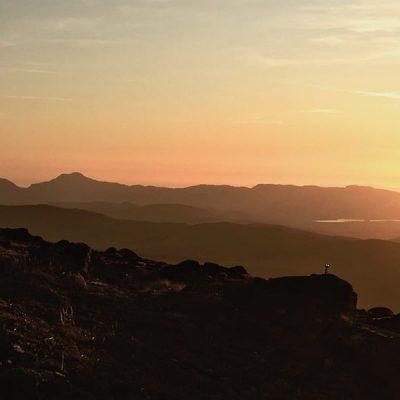 Sian taking sunset photos at Arenig Fawr summit